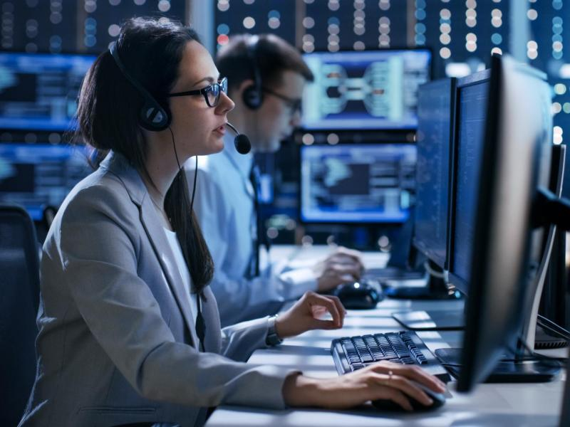 stock-photo-female-working-in-a-technical-support-team-gives-instructions-with-the-help-of-the-headsets-in-the-669170680