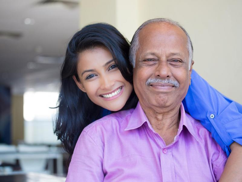 stock-photo-closeup-portrait-family-young-woman-in-blue-shirt-holding-older-man-in-pink-collar-button-down-371809282 (1)