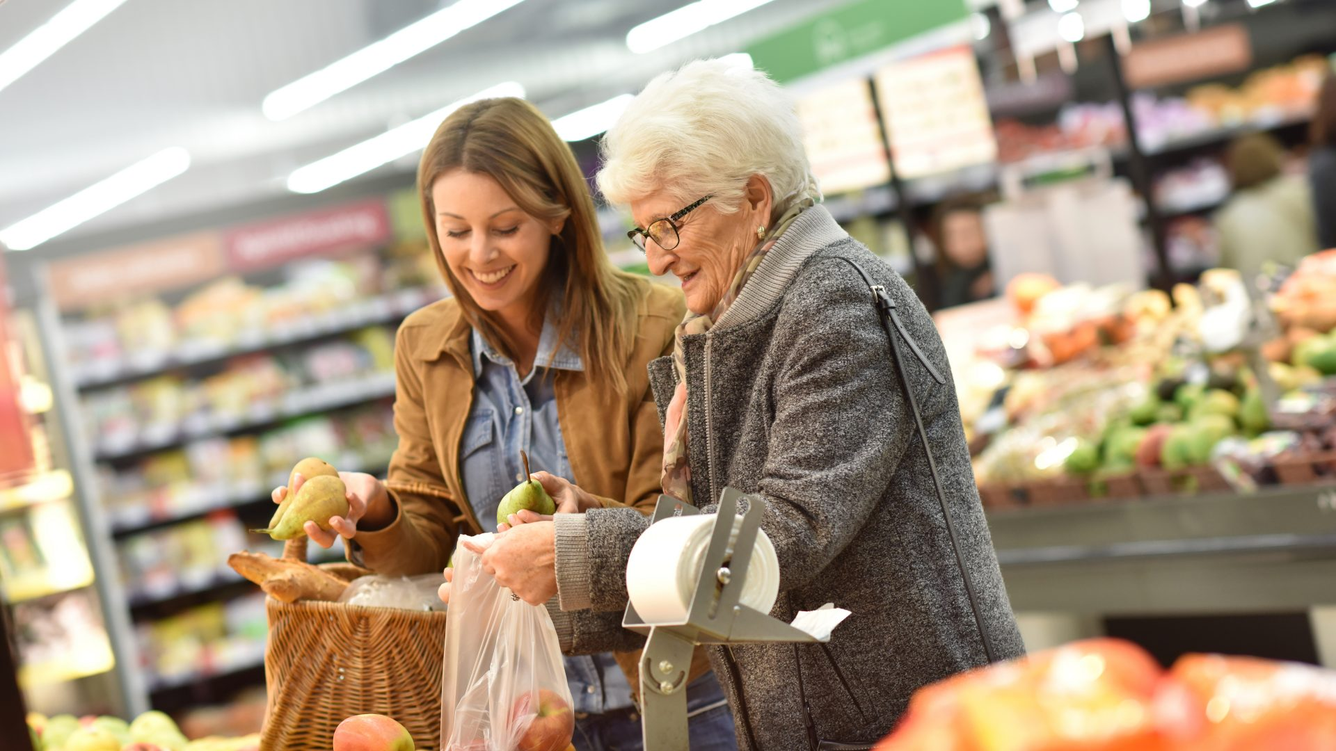 stock-photo-elderly-woman-with-young-woman-at-the-grocery-store-371623984