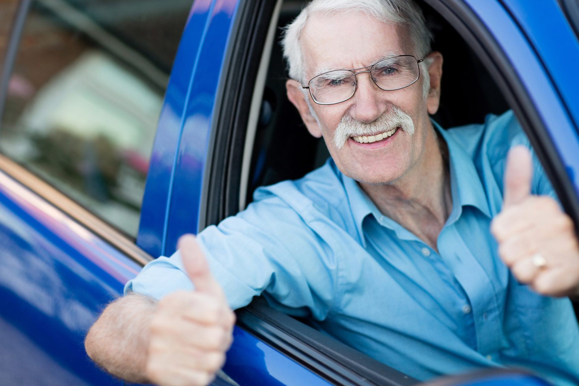stock-photo-man-driving-a-car-and-showing-thumbs-up-113829472