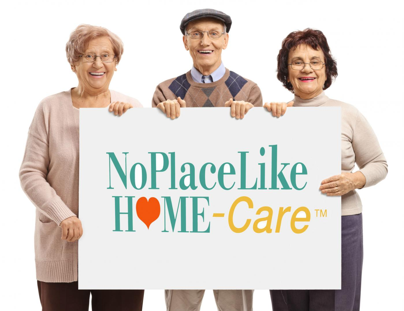 no place like home care sign held up by clients